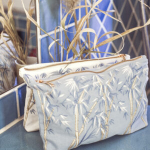 Elizabeth Scarlett Bamboo Pouches in Blue and White on Bathroom Shelf
