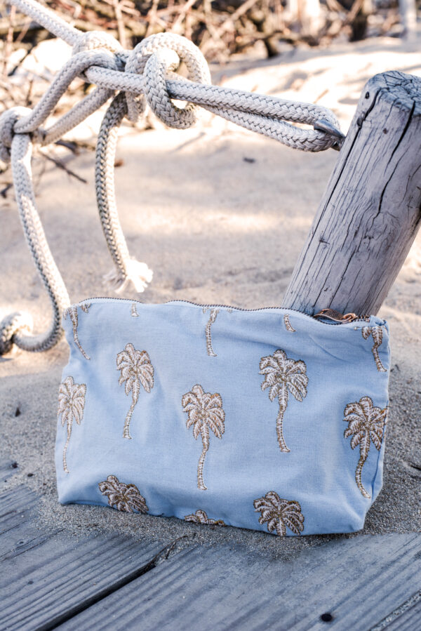 Elizabeth Scarlett Palmier Pouch in chambray blue on beach