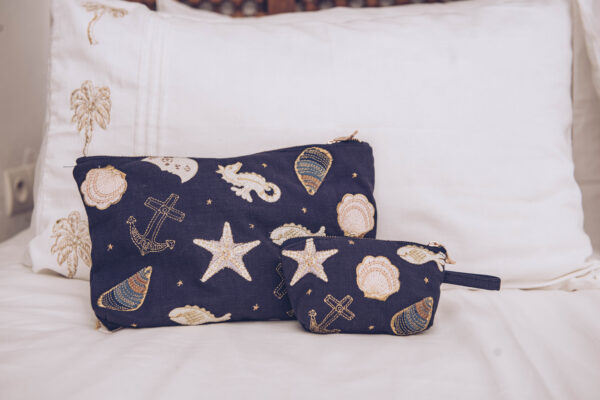 Elizabeth Scarlett Seashell Travel Pouch and Coin Purse on Bed