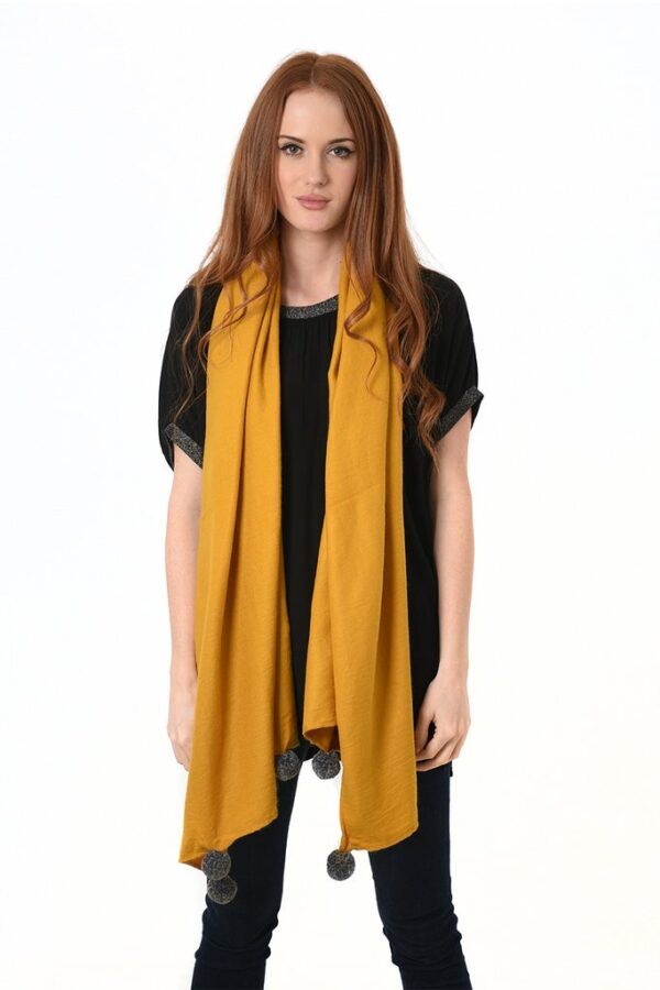 Mustard Blanket Scarf with Large Grey Pom Poms in use 2